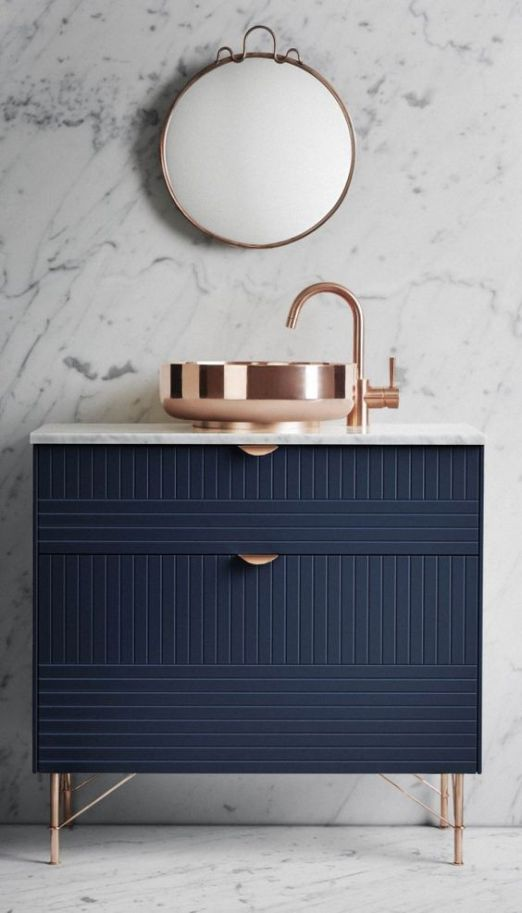 Stylish-and-modern-dark-blue-bathroom-vanity-with-copper-details-like-sink-.jpg